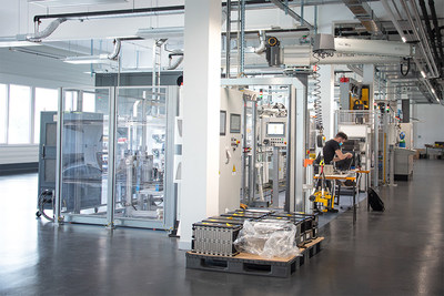 Leclanché's new module assembly line in Yverdon, Switzerland. The foreground shows the end of line tester that ensures the battery module's quality and safety.